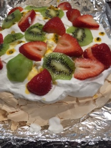 In Australia and New Zealand to celebrate we whip egg whites and slow bake into a gooey meringue topped with cream and fruit.